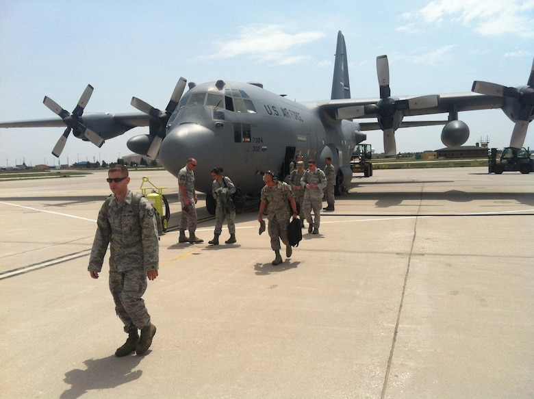 Members of 146th Airlift Wing Maintenance hitch a ride on a C130-H from Colorado Springs, Colo. to Cheyenne, Wyo. July 5, 2012, where U.S. Forest Service continues to battle the wildfires with MAFFS (Modular Airborne Firefighting Systems) operations in the Rocky Mountain region.   MAFFS efforts have been focused on the Squirrel Creek fire about 70 miles west of Cheyenne. (U.S. Air Force Photo/Senior Airman Nicholas Carzis)