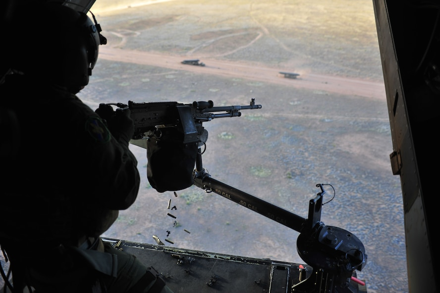 U.S. Air Force Staff Sgt. Casey Spang, 20th Special Operations Squadron flight engineer, fires a 50 caliber weapon out the back of a CV-22 Osprey while flying over Melrose Air Force Range, N.M., July 5, 2012. The 20 SOS conducted a routine training flight over Melrose. (U.S. Air Force photo by Airman 1st Class Alexxis Pons Abascal)