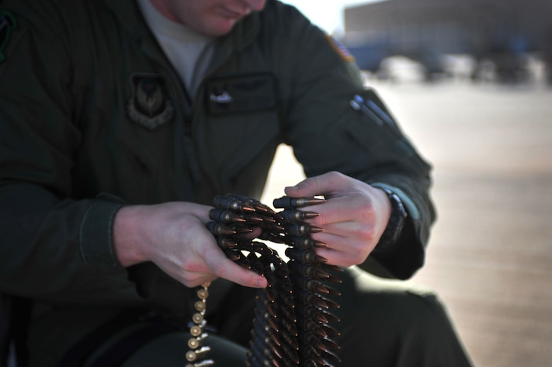 U.S. Air Force Staff Sgt. Casey Spang, 20th Special Operations Squadron flight engineer, inspects ammunition prior to takeoff on the flightline at Cannon Air Force Base, N.M., July 5, 2012. The 20 SOS conducted a routine training flight over Melrose Air Force Range, N.M. (U.S. Air Force photo by Airman 1st Class Alexxis Pons Abascal)