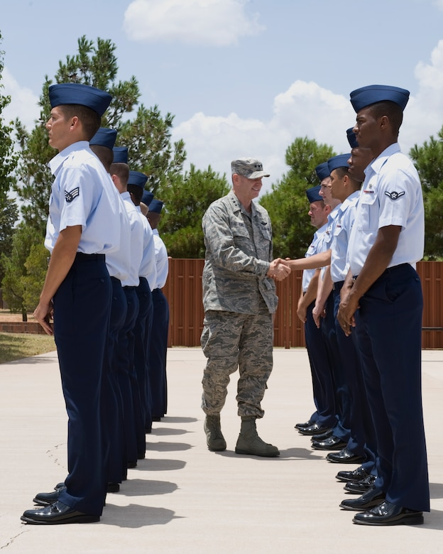 U.S. Air Force Lt. Gen. Robin Rand, 12th Air Force commander, visits with Dyess Honor Guard Airmen July 2, 2012, at Dyess Air Force Base, Texas. During his visit, Rand expressed his gratitude to all Dyess Airmen and their families for their outstanding support of global missions and operations. (U.S. Air Force photo by Staff Sgt. Richard P. Ebensberger/ Released)