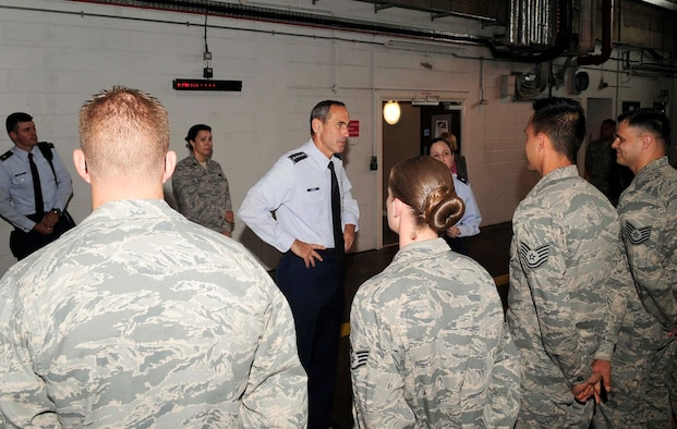RAF MILDENHALL, England – Gen. Raymond Johns, Air Mobility Command commander, meets Airmen from the 727th Air Mobility Squadron during a site visit here, July 5, 2012. The 727th AMS is a tenant unit based out of RAF Mildenhall. (U.S. Air Force photo/Senior Airman Ethan Morgan)