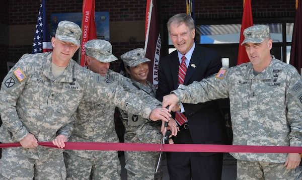 DoD and congressional officials cut the ribbon on a new Warrior in Transition facility at Ft. Drum