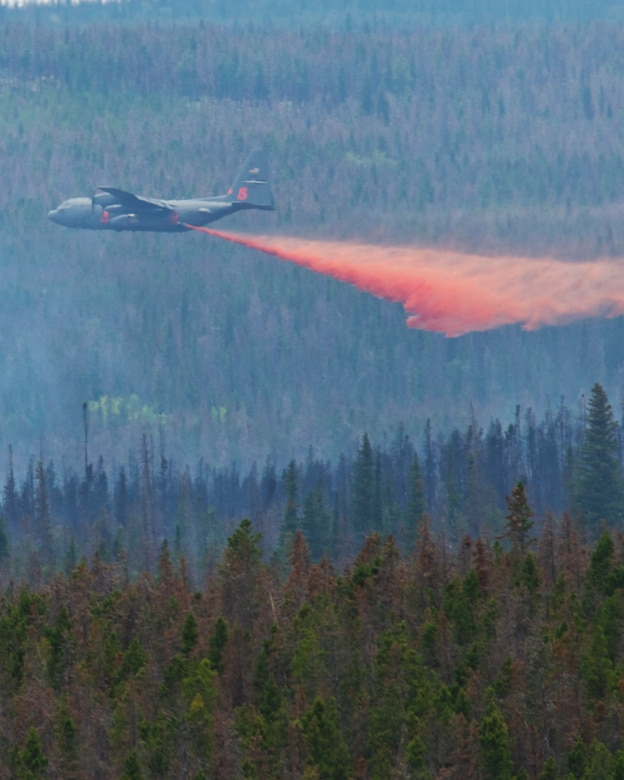 A C130-H equipped with Modular Airborne Firefighting Systems (MAFFS) from the 302nd Air Force Reserve Command in Colorado Springs, Colo. drops retardant near the Squirrel Creek fire about 70 miles east of Cheyenne. MAFFS is a self-contained aerial firefighting system owned by the U.S. Forest Service that can discharge 3,000 gallons of water or fire retardant in less than 5 seconds, covering an area one-quarter of a mile long by 100 feet wide. Once the load is discharged, it can be refilled in less than 12 minutes. (U.S. Air Force photo / Senior Airman Nicholas Carzis)