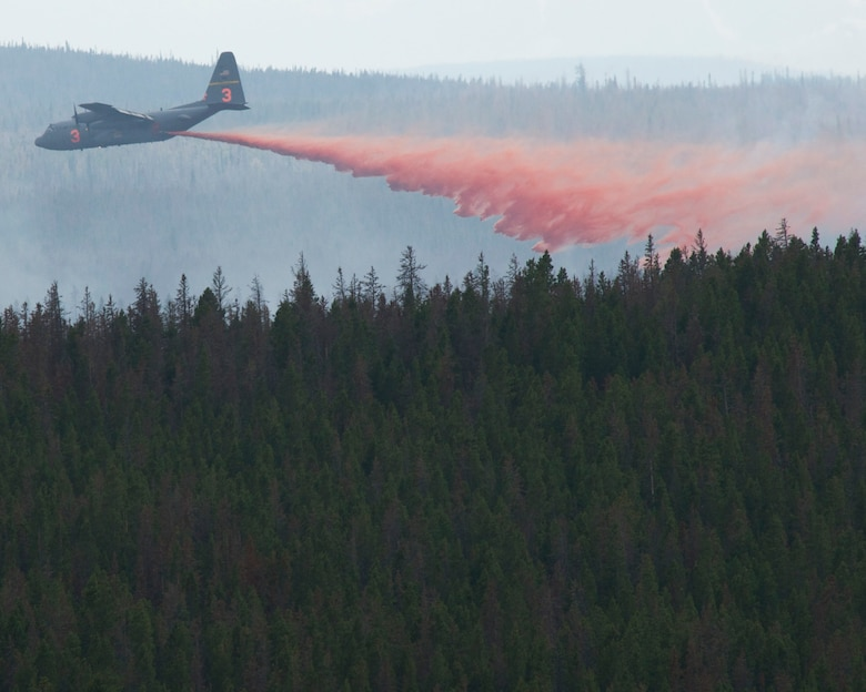 A C130-H equipped with Modular Airborne Firefighting Systems (MAFFS) from the 153rd Airlift Wing in Cheyenne, Wyo. drops retardant near the Squirrel Creek fire about 70 miles east of Cheyenne, July 6, 2012. MAFFS is a self-contained aerial firefighting system owned by the U.S. Forest Service that can discharge 3,000 gallons of water or fire retardant in less than 5 seconds, covering an area one-quarter of a mile long by 100 feet wide. Once the load is discharged, it can be refilled in less than 12 minutes. (U.S. Air Force photo / Senior Airman Nicholas Carzis)
