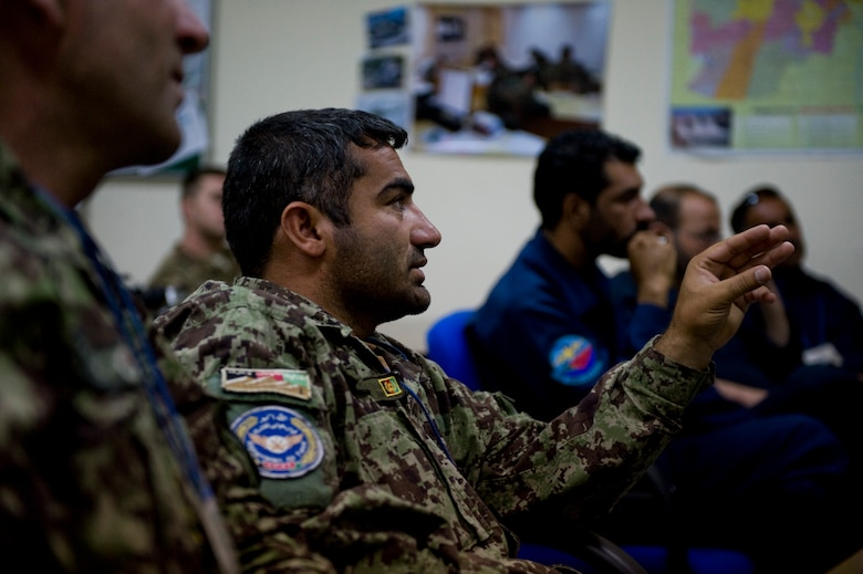 A member of the Afghan air force asks a question about different gauged wires during a training class in Kabul, Afghanistan on July 7, 2012. Afghan air force Electrical and Radio C-27A maintainers took part in the four-day class to learn the tools, safety procedures and practical hands-on application of electrical aircraft wiring.(U.S. Air Force photo by Staff Sgt. Greg C. Biondo)(Released)