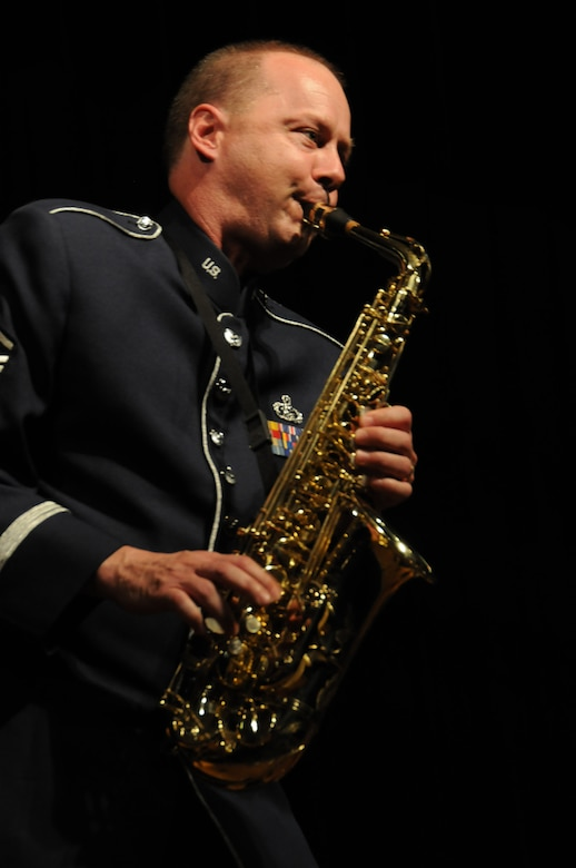 Master Sgt. Stanley George a saxophonist with the 555th Air Force Band performs a solo during the final concert and deactivation ceremony of the 555th Air Force Band, also known as the Triple Nickel and Air National Guard Band of the Great Lakes. The event took place at Anthony Wayne High School, Whitehouse, Ohio, July 7, 2012. The band dating back 1923 will be officially deactivated in 2013 after 90 years of service. (U.S. Air Force photo by Senior Airman Amber Williams/Released)