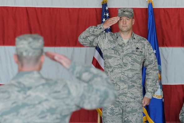 U.S. Air Force Col. Dane West, receives his first salute after taking command of his group during the 388th Maintenance Group change of command ceremony at Hill Air Force Base, Utah, June 29. The ceremony marks the official acceptance of West as the 388 MXG newest commander. (U.S. Air Force Photo/Todd Cromar/Released)
