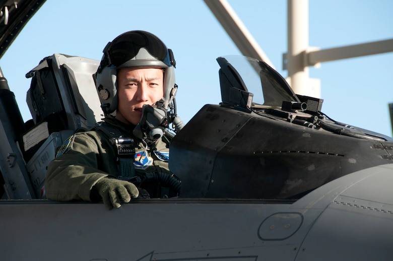 Japan Air Self-Defense Force 1st Lt. Kazuhiro Ota prepares for an F-16 Fighting Falcon training mission on the 162nd Fighter Wing flightline at Tucson International Airport, Feb. 22.  Ota and two other Japanese pilots currently in training here are set to graduate from the Air Guard's international F-16 school house this fall. (U.S. Air Force photo/Master Sgt. Dave Neve)