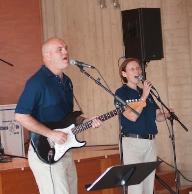 (Left) Staff Sgt's Jason Cale and Rachel Trimble (Right) perform a song for children attending the Roveredo in Piano music school July 6 at Roveredo, Italy. Cale and Trimble are part of the U.S. Air Forces in Europe band Check Six who performed for aspiring musicians in the local community. (U.S. Air Force photo/Airman 1st Class Briana Jones)