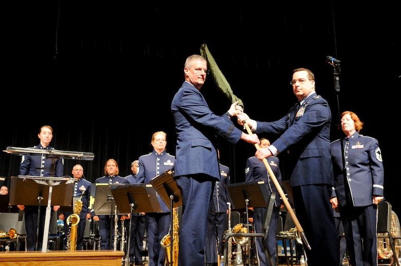 Maj. Matthew Zelnik, commander of the 555th Air Force Band relinquishes command of the band to The Ohio National Guard Assistant Adjutant General for Air, Brig. Gen. Mark Bartman, during a deactivation ceremony at Anthony Wayne High School in Whitehouse, Ohio July 7, 2012. The band, commonly called The Triple Nickel, performed for the final time during the deactivation ceremony. Dating back to 1923, the band is scheduled to be officially deactivated in 2013 after nearly a century of service as part of the Ohio Air National Guard. (U.S. Air Force photo by Master Sgt. Beth Holliker/Released)