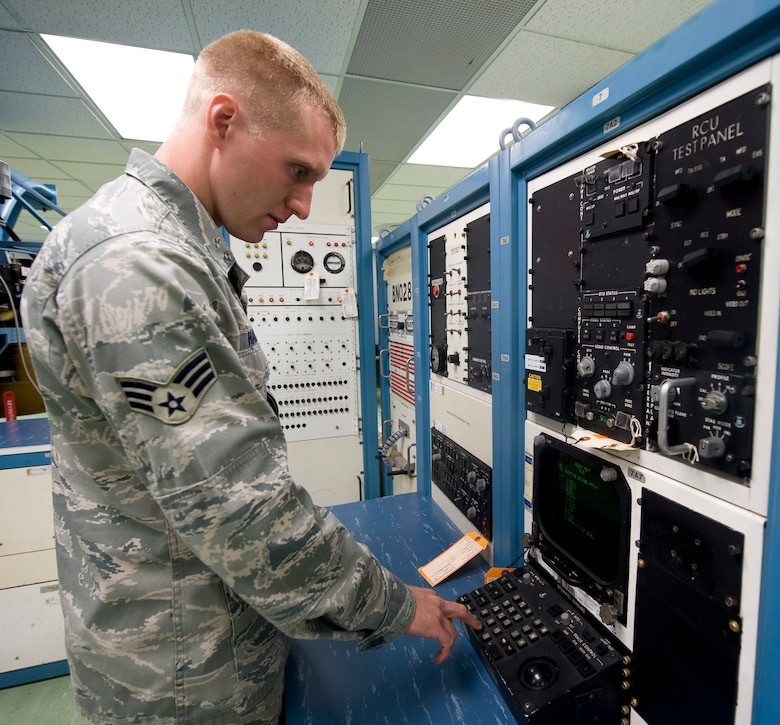 Senior Airman David Hammett, 2nd Maintenance Squadron Avionics Flight, calibrates equipment used to test an antenna from a B-52H Stratofortress on Barksdale Air Force Base, La., July 10. Airmen from the avionics flight maintain the equipment that gives the aircraft weather mapping, ground mapping, aircraft detection, defense and communications capabilities. (U.S. Air Force photo/Staff Sgt. Chad Warren)(RELEASED)