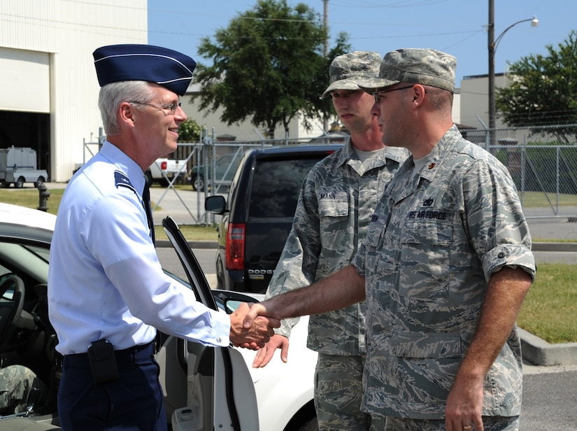 Brig. Gen. Les Kodlick, Director of Public Affairs, Office of the Secretary of the Air Force, the Pentagon, Washington D.C., is greeted by Maj. Jason Bowden, 628th Logistics Readiness Squadron operations officer, during his visit to Joint Base Charleston July 10, 2012. Kodlick received a briefing on 628th LRS Port Opertaions after attending the 1st Combat Camera Squadron change of command earlier that day. Kodlick is responsible for developing and executing global communication processes to build understanding and support for the Air Force. (U.S. Air Force photo/Airman 1st Class Ashlee Galloway)