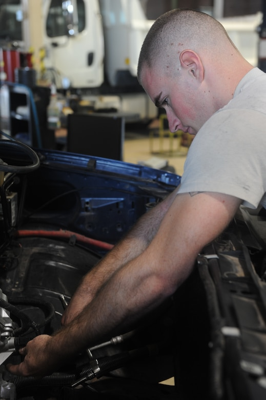 Airman 1st Class Josh Jensen, 49th Logistics Readiness Squadron vehicle equipment maintenance apprentice, loosens a vehicle's bolt at the Holloman Air Force Base N.M., vehicle shop July 12. Jensen was working on the vehicle's front-timing cover, which is used to protect components such as the timing gears, chain and belt in the vehicle. The 49th LRS vehicle maintenance team takes care of the wing's entire vehicle fleet. (U.S. Air Force photo by Airman Leah Ferrante/Released)