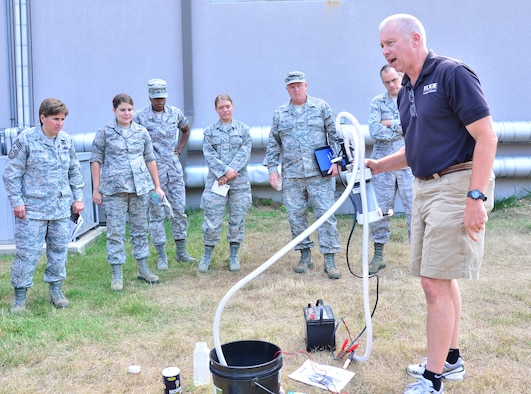 WRIGHT-PATTERSON AIR FORCE BASE, Ohio - Jeff Klingman, an EDGE Outreach representative, demonstrates the water purification machine from EDGE Outreach at the 445th Airlift Wing June 29. Trained volunteers can install a mini water treatment facility anywhere in the world that can service a village of up to 10,000 people indefinitely. (U.S. Air Force photo/Staff Sgt. Amanda Duncan)