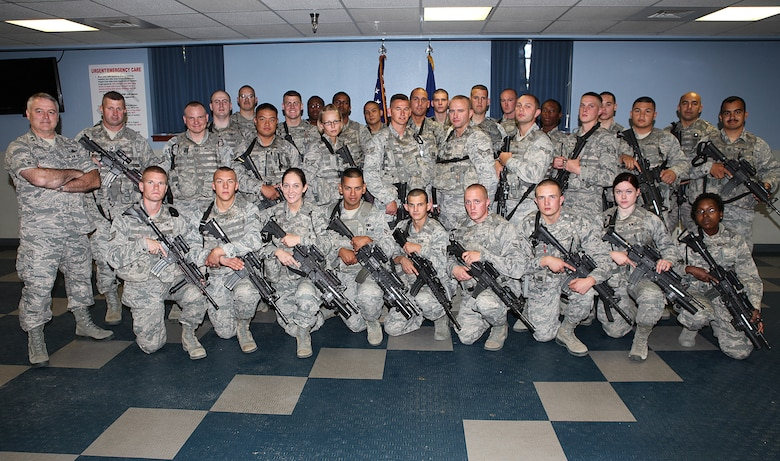 Maj. Gen. Michael J. Carey, 20th Air Force commander, poses for a group photograph with Security Force members following gaurd mount Friday, July 6. General Carey observed Guard Mount and spoke to the troops as part of his visit to F. E. Warren AFB. During his first visit to the 90th Missile Wing as the 20th AF commander, Carey engaged with Airmen from the 90th Security Forces Group, the 90th Maintenance Group and the 90th Logistics Readiness Squadron. (U.S. Air Force photo by Matt Bilden)
