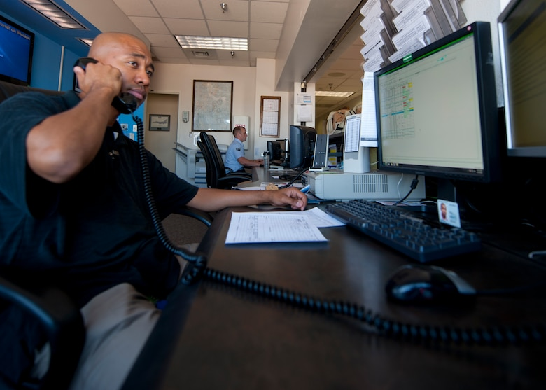 Julius Griffin, 49th Operations Support Squadron airfield manager, fields a phone call from the air traffic control tower at Holloman Air Force Base, N.M., June 26. Communications with air traffic control is an integral part of an airfield manager's job. Airfield managers are responsible for relaying all the information they receive from air traffic control to the proper authorities. (U.S. Air Force photo by Airman 1st Class Daniel E. Liddicoet/Released)