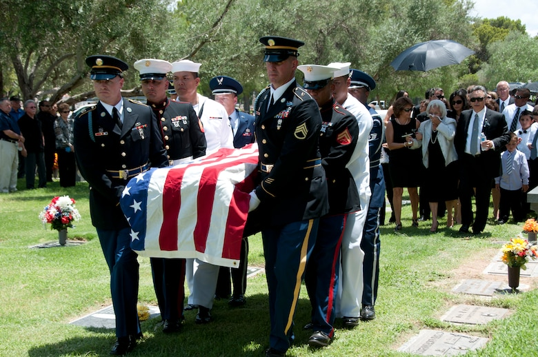 Guard and Reserve servicemembers representing all branches of the United States armed forces carry Bill Valenzuela to his final resting place at Holy Hope Cemetery in Tucson, Ariz., July 12. Valenzuela was a veteran of the Korean War having served in the United States Marine Corps Reserve in Tucson. He was Arizona's Chairman for Employer Support for the Guard and Reserve and was later named Chair Emeritus - constantly working to promote understanding and support between employers and their National Guard and Reserve member employees. He was a member of the Arizona Veteran's Hall of Fame and he garnered countless Lifetime Achievement Awards and Man of the Year Honors from business and philanthropic organizations nationwide. (U.S. Air Force photo/ Master Sgt. Dave Neve)