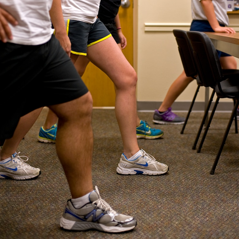 Participants practice a calf stretch during the running clinic in the Health and Wellness Center at Hurlburt Field, Fla., July 11, 2012. Maintaining the physical resiliency of Airmen ensures they are fit to fight.  (U.S. Air Force photo/Airman 1st Class Michelle Vickers) (RELEASED)