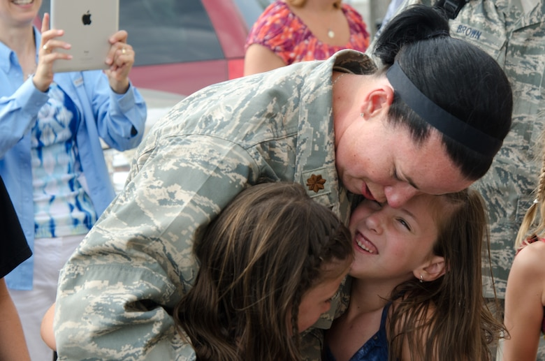Members of the 139th Civil Engineering Squadron return home from Guantanamo to the 139th Airlift Wing, St. Joseph, Mo., Thursday July 12, 2012. (Air National Guard photo by Senior Airman Kelsey Stuart/Released)