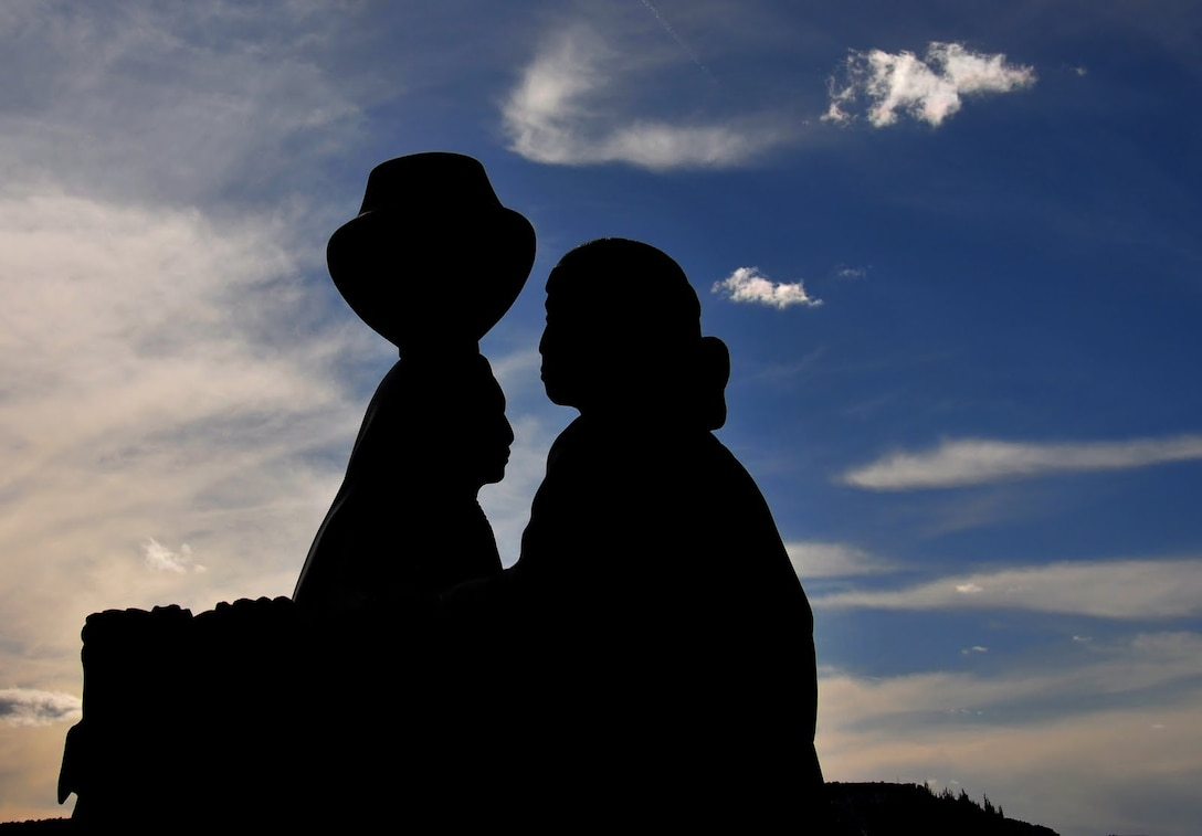 Richard Banker, in the District's Cost Engineering Branch, took this photo at the Acoma Pueblo Visitor Center. He said the scene really jumped out at him, as the light created silhouettes of the pueblo women, depicted in the statue, against the blue sky.