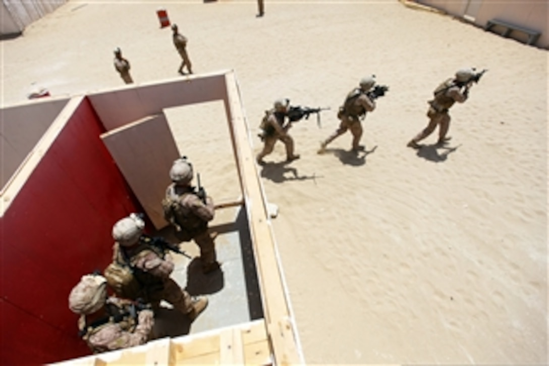 U S  Marines move between buildings during close-quarters