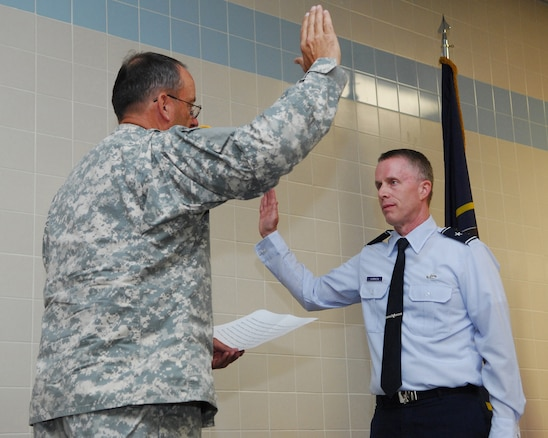 Maj. Gen. Brian Tarbet, the Adjutant General for Utah, administers the oath of office to newly promoted Brig. Gen. Kenneth L. Gammon, Chief of Staff, Utah Joint Force Headquarters Air, on July 14, 2012, at the Utah Air Guard base in Salt Lake City, Utah. (U.S. Air Force photo by Master Sgt. Gary J. Rihn)(Released)