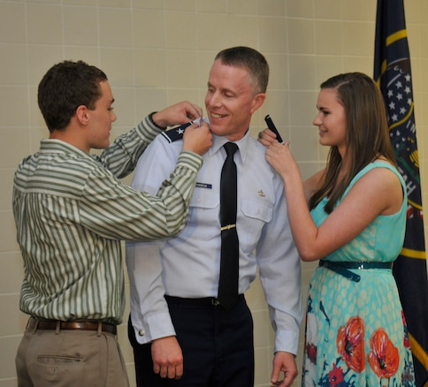 Brig. Gen. Kenneth L. Gammon, Chief of Staff, Utah Joint Force Headquarters Air, has his new rank pinned on by his son Kyle and daughter Gabriella, at his promotion ceremony at the Utah Air National Guard Base in Salt Lake City, on July 14, 2012. (U.S. Air Force photo by Tech. Sgt. Jeremy Giacolletti-Stegall)(Released)