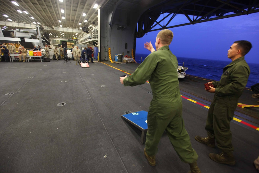 Marines with the 24th Marine Expeditionary Unit participate in various games in the hangar of USS Iwo Jima in celebration of the 4th of July while deployed at sea. The 24th MEU is deployed with the Iwo Jima Amphibious Ready Group as a theater reserve force for U.S. Central Command. The group is providing support for maritime security operations and theater security cooperation efforts in the U.S. Navy's 5th Fleet area of responsibility.