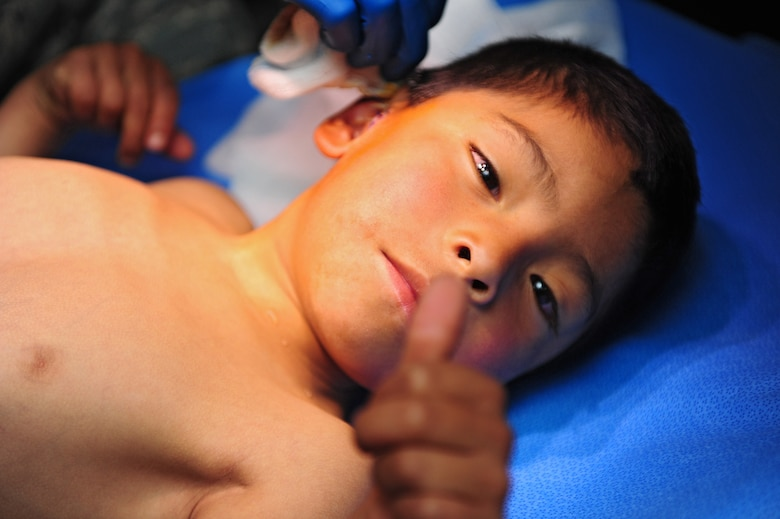 A Peruvian boy gives a thumbs up after surgery at an Expeditionary Medical Support mobile field hospital in Huancavelica, Peru, July 2, 2012, during New Horizons 2012. New Horizons is a U.S. Southern Command-sponsored annual series of joint humanitarian assistance exercises deploying U.S. military engineers, veterinarians, medics and other professions to Central and South American nations for training, construction projects and to provide humanitarian and medical services. (U.S. Air Force photo by Staff Sgt. Michael C. Zimmerman/Released)