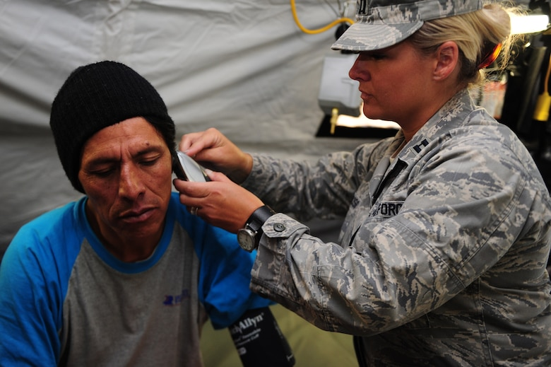 U.S. Air Force Capt. Jody Huss, right, checks the vital signs of a Peruvian patient at a health response team Expeditionary Medical Support mobile field hospital in Huancavelica, Peru, July 2, 2012, during New Horizons 2012. New Horizons is a U.S. Southern Command-sponsored annual series of joint humanitarian assistance exercises deploying U.S. military engineers, veterinarians, medics and other professions to Central and South American nations for training, construction projects and to provide humanitarian and medical services. (U.S. Air Force photo by Staff Sgt. Michael C. Zimmerman/Released)