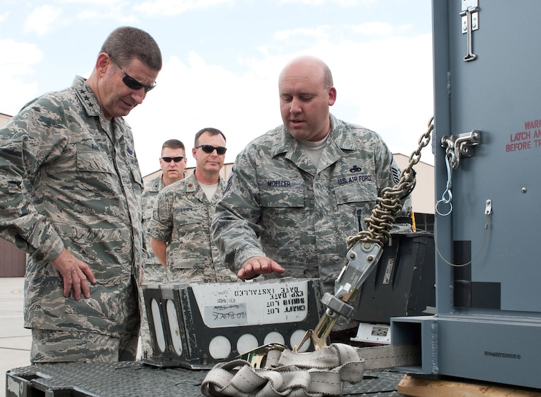 Master Sgt. Wade Moeller, 28th Munitions Squadron armament maintenance NCO in charge, explains B-1 bomber chaff and flare transport modules to Lt. Gen. Robin Rand, 12th Air Force commander, on the flightline during the general's visit at Ellsworth Air Force Base, S.D., July 12, 2012. Rand toured all the bases under the 12th AF command to discuss mission priorities and gain insight to operational successes and shortfalls. (U.S. Air Force photo by Airman 1st Class Alystria Maurer)