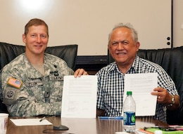 WASHINGTON — Col. Bruce Estok, U.S. Army Corps of Engineers Seattle District Commander, and Merle Jefferson, Lummi Natural Resource Department Executive Director, meet July 6, 2012 for final signatures. Federal agencies worked together with the Lummi Nation to establish the first federally authorized Native American sponsored commercial wetland and habitat mitigation bank in the nation.