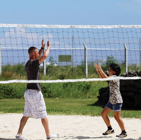 Pfc. Christopher J. Frigon prepares to give a high-five to a child from the Tai Chu En orphanage::r::::n::during a community relations event at Camp Kinser July 16. Every year, there are many community::r::::n::relations events on Okinawa, and throughout the Asia-Pacific region during exercises, according::r::::n::to Kaori Martinez, community relations officer with G-7, government and external affairs office,::r::::n::Marine Corps Installations Pacific. Frigon is data network specialist with Combat Logistics Regiment::r::::n::35, 3rd Marine Logistics Group, III Marine Expeditionary Force.