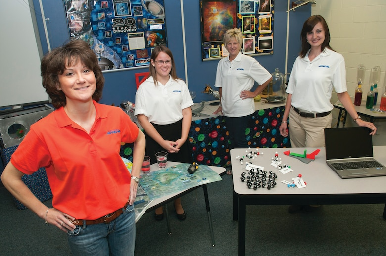 Sherra Triggs, left, is the Martinsburg Starbase program director and has been with the program since its inception at the 167th Airlift Wing a decade ago. Instructor Ashley Spies, office manager Michelle Linaburg, and instructor Shannon Boone are also pictured. Starbase instructors not pictured are Laura Meske and Chris Fleming. (Air National Guard photo by Emily Beightol-Deyerle)