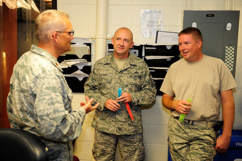 Chaplain (Maj.) David Knight (left), 20th Fighter Wing flight line chaplain, speaks with Senior Master Sgt. Steven Cooker (center), 20th Civil Engineer Squadron heating ventilation and air conditioning NCOIC, and Tech. Sgt. William Brown, 20th CES assistant HVAC NCOIC, about how their squadron and daily duties are going at Shaw Air Force Base, S.C., July 16, 2012. Chaplains and their assistants get out and among Team Shaw to help in any way they can as they connect on the personal level. (U.S. Air Force photo/Airman 1st Class Daniel Blackwell/Released)