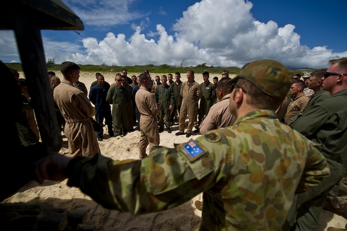 Marines assigned to Combat Assault Company, 3rd Marine Regiment, and Royal Australian Army Capt. Ken Semmens, cavalry officer from Townsville, Queensland, gather near the back of a R7-A1 amphibious assault vehicle on Pyramid beach for a safety briefing prior to splashing into the ocean July 12, to meet up with the USS Essex (LHD-2) off shore during the Rim of the Pacific Exercise 2012. Twenty-two nations, more than 40 ships and submarines, more than 200 aircraft and 25,000 personnel are participating in RIMPAC exercise from Jun. 29 to Aug. 3, in and around the Hawaiian Islands. The world's largest international maritime exercise, RIMPAC provides a unique training opportunity that helps participants foster and sustain the cooperative relationships that are critical to ensuring the safety of sea lanes and security on the world's oceans. RIMPAC 2012 is the 23rd exercise in the series that began in 1971.