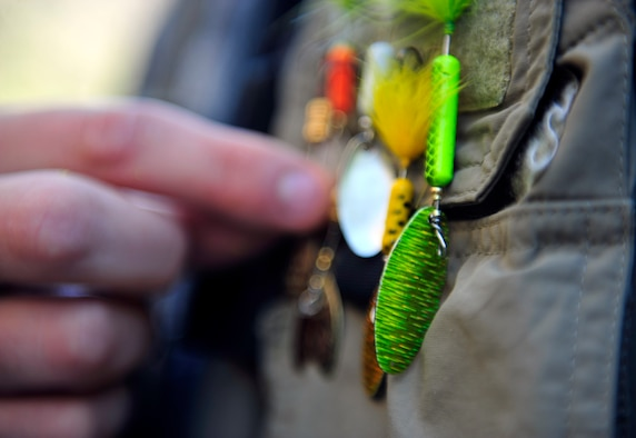 CLEAR CREEK, Colo. – Christopher Gross, 460th Space Wing Public Affairs, detaches a lure off of his fishing vest while fishing at Clear Creek July 10,2012. The Creek is home to Browns, Brooke, Rainbow and Cutthroat trout. (U.S. Air Force photo/Senior Airman Paul Labbe.)