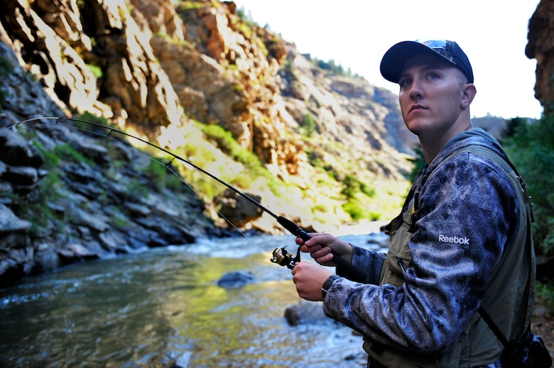 CLEAR CREEK, Colo. – Christopher Gross, 460th Space Wing Public Affairs, fishes at Clear Creek July 10,2012.Clear Creek flows through Clear Creek Canyon in the Rocky Mountains directly west of Denver, descending through a long gorge to emerge on the Colorado Eastern Plains where it joins the South Platte.(U.S. Air Force photo/Senior Airman Paul Labbe.)
