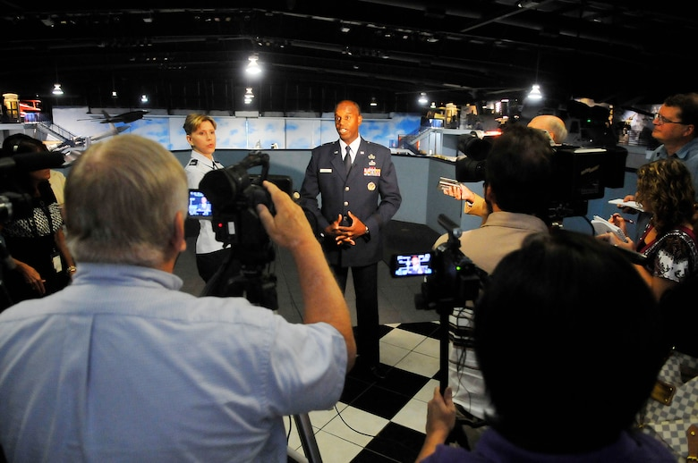 Brig. Gen. Cedric D. George talks with media prior to the ceremony for the standup of the Warner Robins Air Logistics Complex July 17.  (U. S. Air Force photo/Sue Sapp)