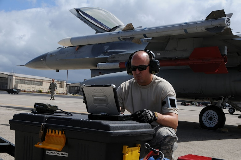 Technical Sgt. Patrick Campos, a crew chief from the 144th Fighter Wing, reviews the technical data for the F-16C Fighting Falcon after a mission on July 14 during RIMPAC 2012. The 2012 Rim of the Pacific exercise is the twenty-third maneuver in a history of bi-annual drills that dates back four decades. The purpose of the exercise is to bring together nations to observe, train and exchange information that fosters a cooperative training environment.  (Air National Guard photograph by MSgt. David J. Loeffler)