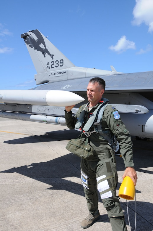 Capt. Matt Eslow of the 194th Fighter Squadron, 144th Fighter Wing, performs a pre-flight inspection on a F-16 fighter jet during RIMPAC 2012.The 2012 Rim of the Pacific exercise is the twenty-third maneuver in a history of bi-annual drills that dates back four decades. The purpose of the exercise is to bring together nations to observe, train and exchange information that fosters a cooperative training environment.  (Air National Guard photograph by MSgt. David J. Loeffler)