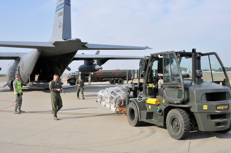 On July 13, Airmen of the 144th Fighter Wing's Logistic Readiness Squadron along with the 136th Airlift Wing's C-130 crew load the last pallet of cargo leaving for the Rim of the Pacific (RIMPAC) exercise taking place at Joint Base Pearl Harbor-Hickam.  The 2012 RIMPAC exercise is the twenty-third maneuver in a history of bi-annual drills that dates back four decades. The purpose of the exercise is to bring together nations to observe, train and exchange information that fosters a cooperative training environment. (Air National Guard photograph by Senior Master Sgt. Chris Drudge)