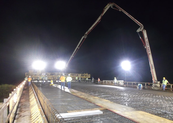FLORIDA — U.S. Army Corps of Engineers Jacksonville District employees and contractor, Kiewit Construction, work through the night to complete the first concrete pour on the bridge deck for theTamiami Trail Modifications project, July 13, 2012.
