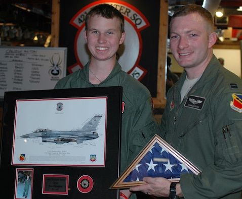 Honorary 'Pilot for a Day' Collin Rowley (left) spent time with the 388th Fighter Wing July 12 at Hill Air Force Base, Utah. Capt. John Loveman, an F-16 pilot with the 421st Fighter Squadron, escorted Rowley and his family to the simulator, air traffic tower and a static display. Rowley was diagnosed with metastatic medulloblastoma, a fatal brain tumor. (U.S. Air Force photo by Andrea Mason/Released).