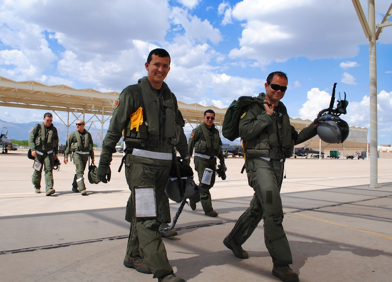 Colombia air force pilots return from flying a sortie in their Kfir fighter aircraft at Davis-Monthan AFB, Ariz. during their preparation to perform in the Red Flag. (U.S. Air Force photo by Staff Sgt. John Ayre)