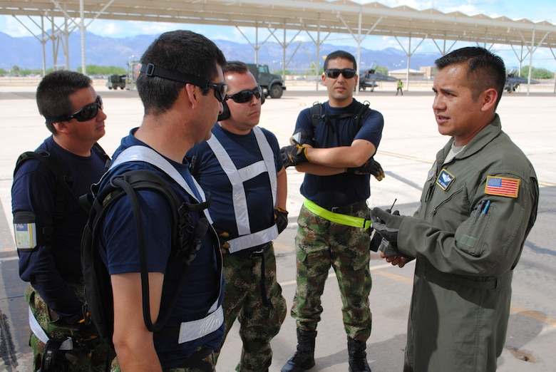 Staff Sgt. Javier Borges, 571st Mobility Support Advisory Squadron air advisor loadmaster, discuss proper palletizing procedures with members of the Colombian air force for their participation in Red Flag (U.S. Air Force photo by Staff Sgt. John Ayre)
