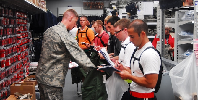 Trainees fill their bags July 3 with things they will need for their 13 weeks at Maxwell. Trainees get all of their clothing and necessary items together as a flight on their second day of their time, here. (U.S. Air Force photo by Airman 1st Class William Blankenship)