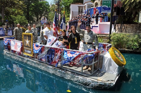 """Lt. Gen. William Caldwell IV, commanding general, U.S. Army North, and senior commander, Fort Sam Houston and Camp Bullis, waves to spectators May 19 as Grand Marshal of the """"Here's to our Heroes"""" Military River Parade. The inaugural parade opened at the Arneson River Theater and featured 25 river floats, representing all branches of the military, veterans, military support groups and more, in honor of Armed Forces Day.  (U.S. Army photo by Staff Sgt. Keith Anderson)"""