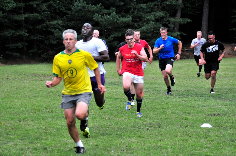 Members of the Ramstein Rogues rugby team run sprints duiring an endurance exercise during a preseason practice at the 435th Construction Training Squadron rugby pitch at Ramstein Air Base, Germany, July 12, 2012. The Rogues have two men's teams and one women's team consisting of Host Nation players, British Royal Air Force and U.S. military Soldiers, Airmen from the Kaiserslautern area and dependents. (U.S. Air Force photo/Airman 1st Class Trevor Rhynes)
