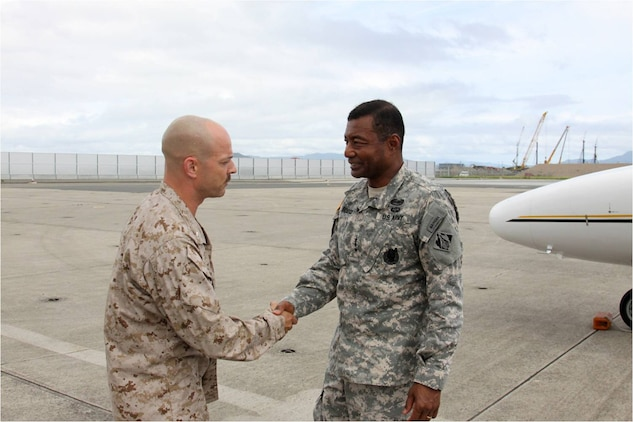 Lt. Col. Gordan J. Limb, station executive officer, greets Army Lt. Gen. Thomas P. Bostick, U.S. Army chief of Engineers and Corps of Engineers commanding general, as he exits his plane here July 19, 2012. Bostick came to the station to see first hand the extensive reconstruction undertaking here.